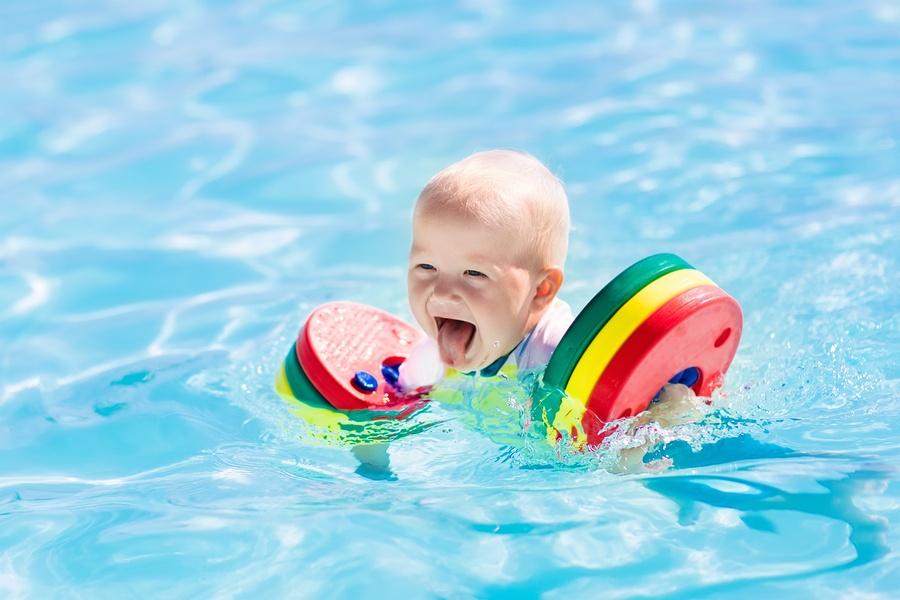 bigstock-Little-Baby-Boy-Playing-In-Swi-174670252.jpg