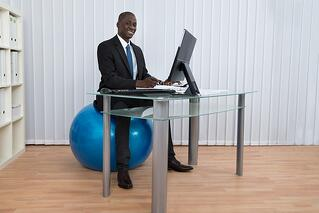 bigstock-Businessman-Working-Sitting-On-96131105.jpg
