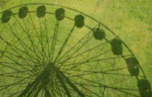 bigstock-Shadow-Of-Ferris-Wheel-fairgr-254773570