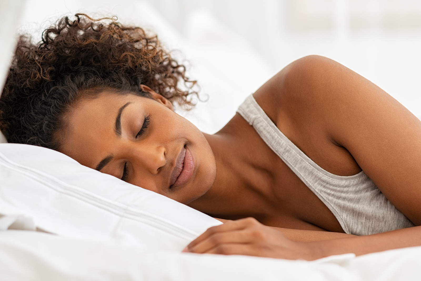 bigstock-Beautiful-young-woman-sleeping-324970987