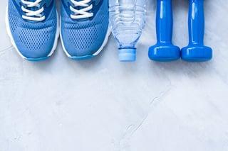 bigstock-Flat-Lay-Sport-Shoes-Bottle-O-154087553.jpg