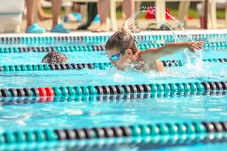 bigstock-Boy-swimming-Butterfly-in-a-ra-77303960.jpg