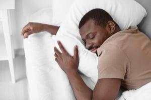 bigstock-African-American-man-sleeping--228702001