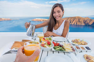 bigstock-Couple-eating-breakfast-at-lux-246880891