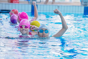 bigstock-Happy-Kids-At-The-Swimming-Poo-250710466