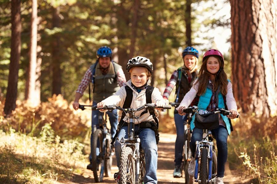 bigstock-Family-mountain-biking-on-fore-123820565.jpg