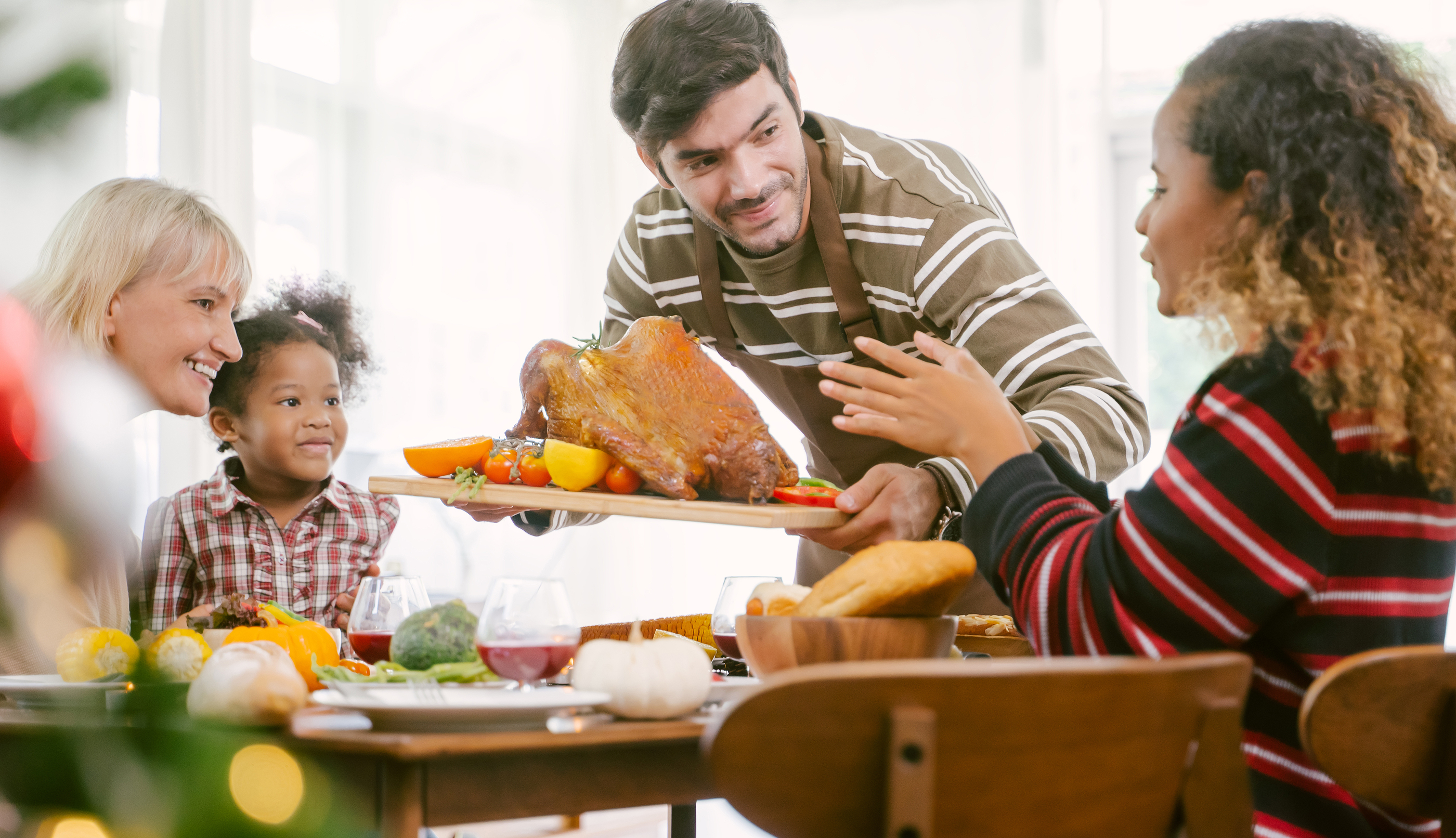 bigstock-Father-Carrying-Turkey-Served--324872740