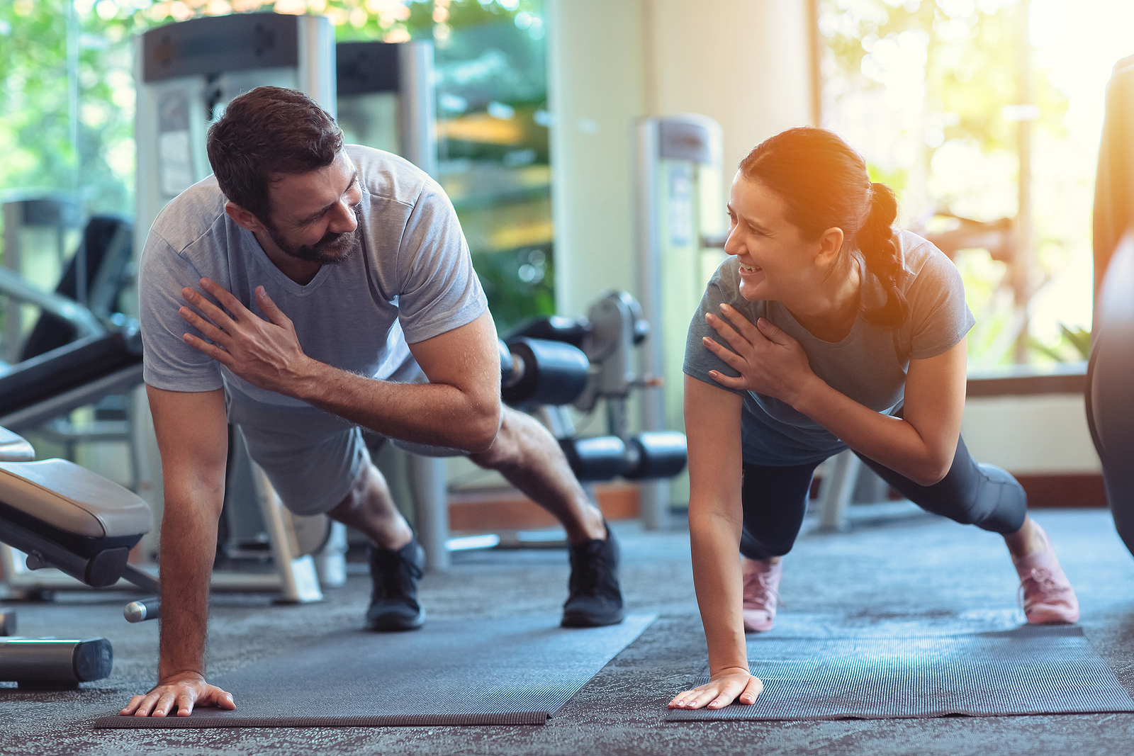 bigstock-Couple-Exercise-Together-In-Gy-368616523