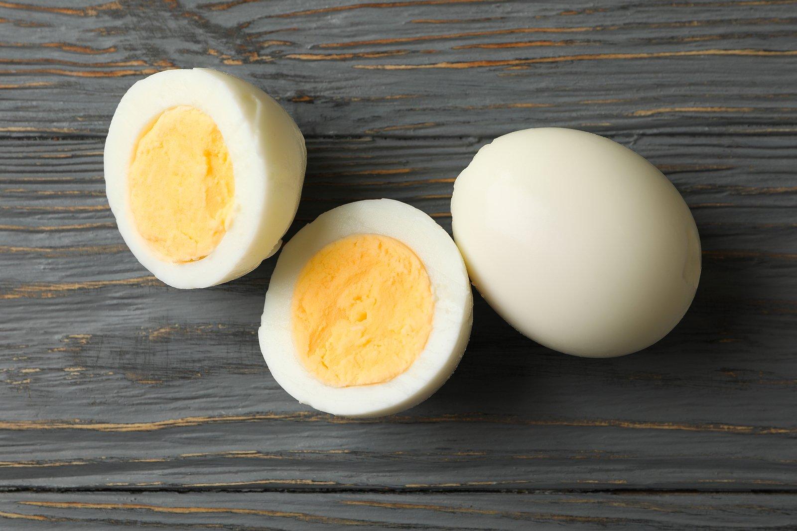 bigstock-Hard-Boiled-Eggs-On-Wooden-Bac-392051996