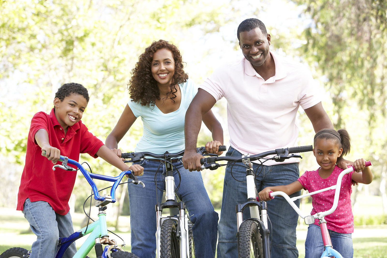 bigstock-Young-Family-Riding-Bikes-In-P-13909514